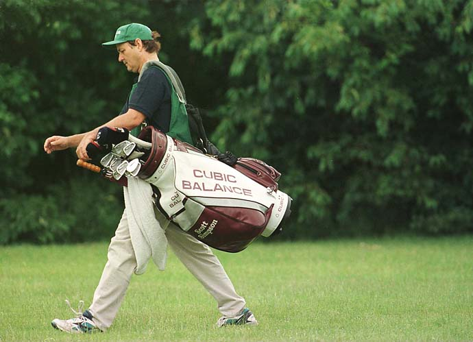 Bill Murray walks down the fairway on the par-4 8th hole carrying the bag of Scott Simpson during the second round of the 1997 Motorola Western Open at Cog Hill Country Club in Lemont, Illinois. To celebrate Murray's 64th birthday on Sept. 21, we've collected his best golf photos from our archives.