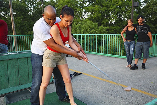 7:56 p.m., Randall's Island Kelstin Batista has a grip on Lissette Ynfante.