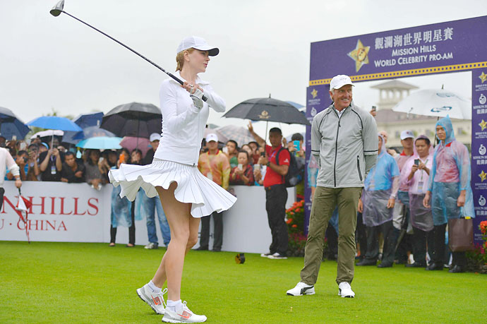 Nicole Kidman has a Marilyn Monroe moment at the World Pro-Am at World Celebrity Pro-Am at China's Hainan Mission Hills as Greg Norman looks on in October 2014.