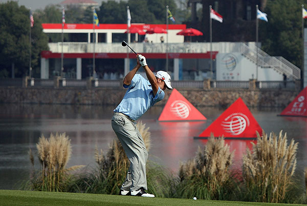 grabbed an early, two-stroke lead in China after a course-record-tying 64.