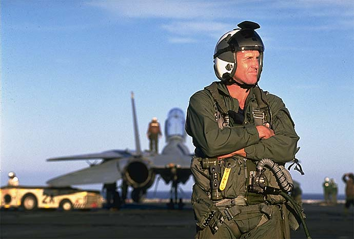 'Top Gun' Greg Norman standing on the deck of U.S. Navy carrier Carl Vinson in December 1995.