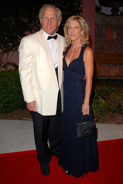 The ultimate golf-tennis power couples, Chris Evert (18 Grand Slam titles) and Greg Norman (two British Open titles), called it quits in October 2009. This photo shows Norman and Evert at a charity auction in Boca Raton, Fla. in 2007.