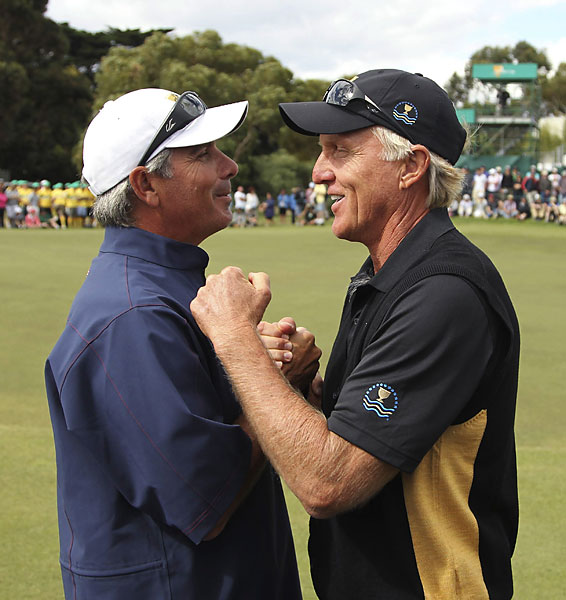 International captain Greg Norman, right, congratulated U.S. captain Fred Couples after the Americans won, 19-15.