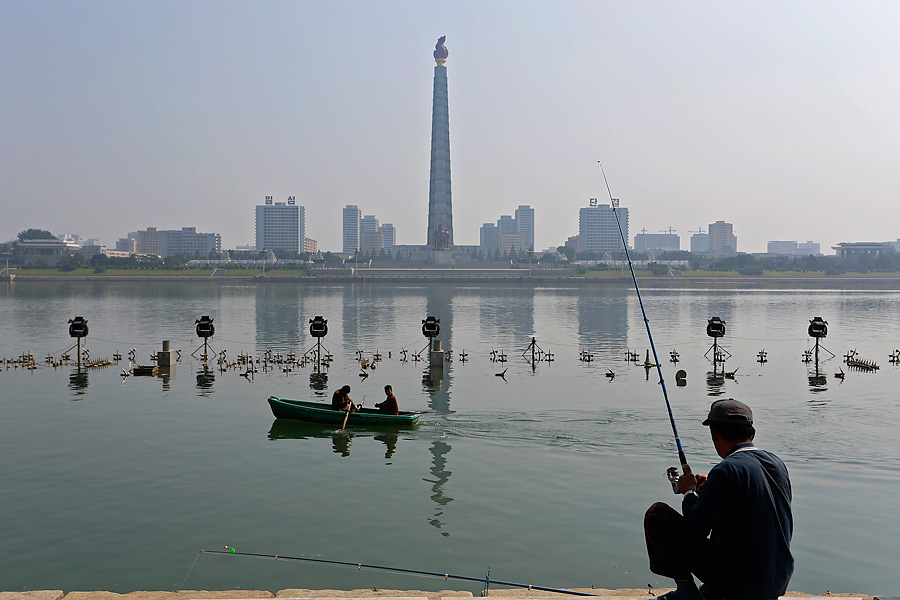 BANK SHOT: A peaceful moment along the Taedong River in Pyongyang. North Korea is so closed off from other nations that it has been nicknamed the Hermit Kingdom.