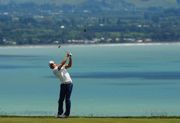Camilo Villegas and Sean O'Hair are tied for the lead through 15 holes at Cape Kidnappers in New Zealand. Play was stopped due to high winds.