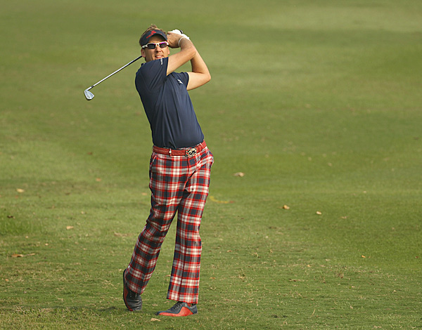 Ian Poulter has made the world safe again for plaid pants. For years he has pushed the golf fashion envelope with his spiked hair, snappy tartan trousers and wild color mixes from his own IJP Design collection. He definitely knows what he is doing.