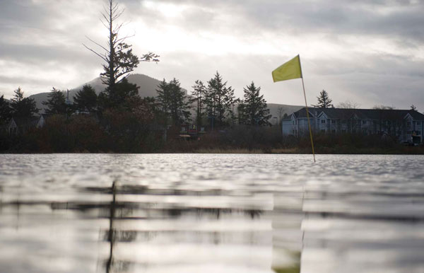 Last week, the Necanicum River rose over its banks in Seaside, Ore. and flooded the ninth hole at Seaside Golf Club.