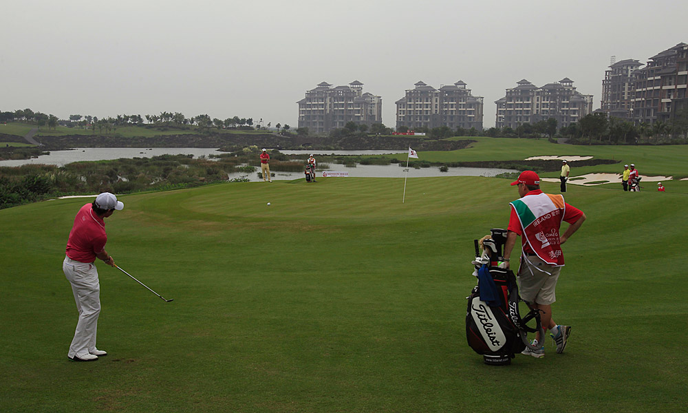 """""""I'm thankful for the young, efficient female caddies at China's Mission Hills Resort, site of this week's WGC-World Cup event. Not only do they clean your ball on the green, but they replace it for you, and don't emerge from their crouch until the lettering has lined up perfectly. The procedure takes some getting used to, but for a guy with a bad back, it's heaven! Happy Thanksgiving!"""" - Joe Passov, Golf Magazine editor-at-large [Pictured: Rory McIlroy at the 2011 World Cup at Mission Hills Resort.]"""