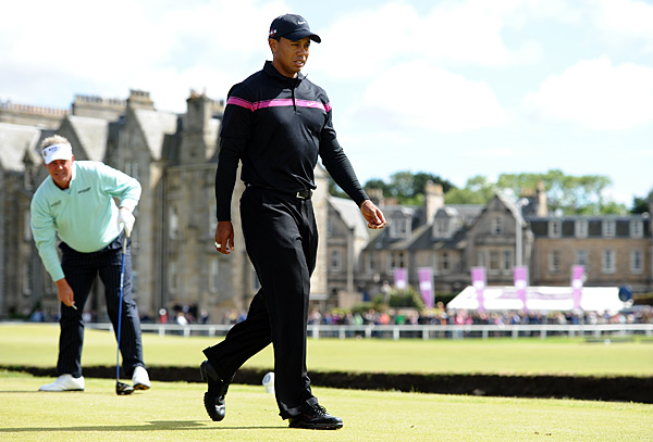 July 15 - The two-time defending champion at St. Andrews, Woods changes putters for the first time in 12 years. He opens with a 67 in calm conditions four shots behind.                       July 18 - For the first time since 1995, Woods is not the Open champion at St. Andrews. Louis Ooshuizen wins by seven shots. Woods finishes 13 shots behind in a tie for 23rd.