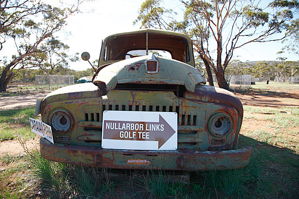 This rusty pick-up truck points players to one of the synthetic tee boxes at Nullarbor Golf Links.