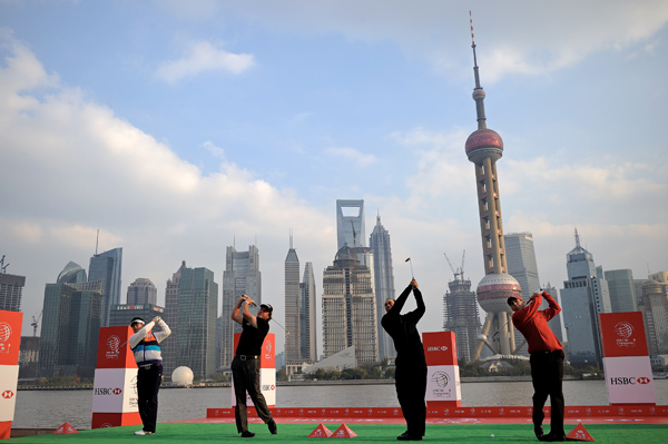 The players hit golf balls into the Shanghai River from the Shanghai Port International Cruise Terminal.
