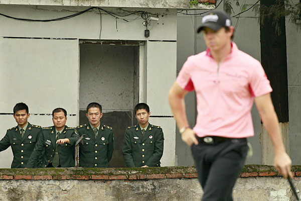 Chinese soldiers looked on as Rory McIlroy shot a three-under 69.