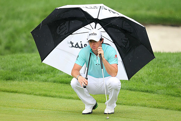 Rory McIlroy moved into contention with a seven-under 65.