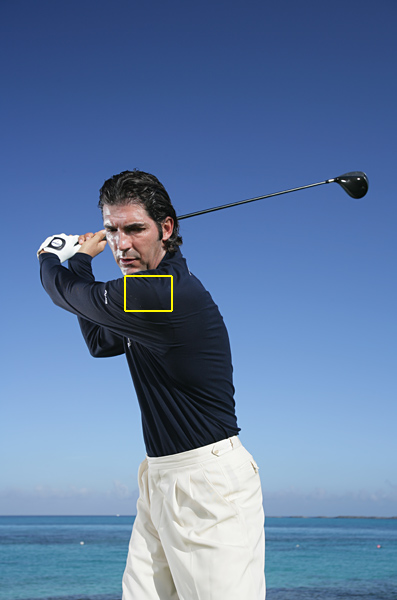 "On your downswing, pull your left shoulder up and away from your chin. It sounds complicated, but it's an easy move. Try it where you are right now: Swing to a mock top position, and then pull your left shoulder up and to the left. Feel how the upward movement of your left shoulder automatically drops your arms and hands down. This is the ""slotting"" move common to all great power swings. It's like a water-skier being whipped around on a line by a boat. In this scenario, your left shoulder is the boat, and your hands are the skier."