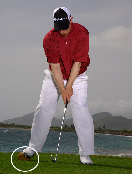 HOW TO STRIKE THE BALL, NOT THE GROUND                                                          Grab a tee marker and place it under your right foot at address. The marker is there to remind you to shift your weight forward during your downswing.