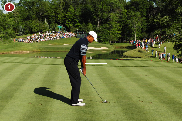 Tiger's impeccable address allows his arms to hang freely while his shoulders, hips, and feet are all parallel to the target. His ability to maintain these same angles throughout his swing is a huge key to his consistency.