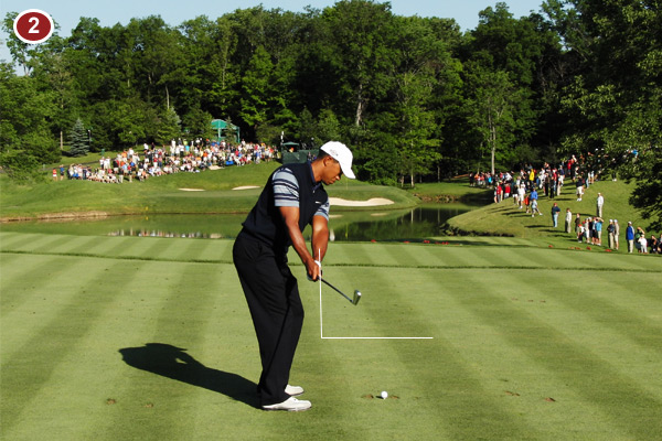 Tiger takes the club back perfectly by simply turning his shoulders, chest and belt buckle away from the target. This allows him to properly rotate his forearms and get the club on the correct path every time.