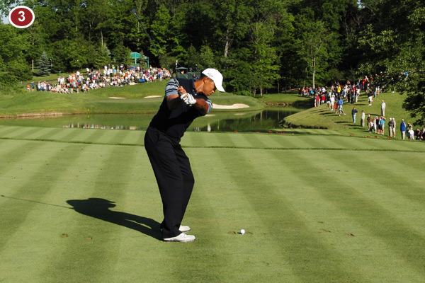 Tiger's body is still clearly in control of his swing as he hinges the club up with his turn. This position is a result of the turning of his body, not an independent movement of the hands and arms.