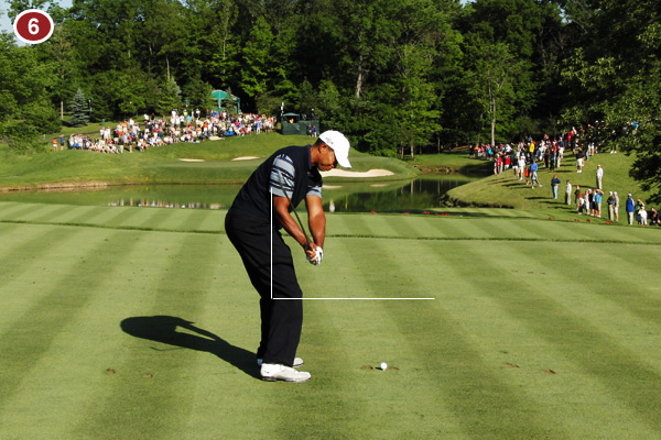 Tiger's arms and club continue to drop downward as his body rotates, which allows the club to travel to impact on an inside-out path. This is the optimal way to ensure excellent clubface-to-ball contact.