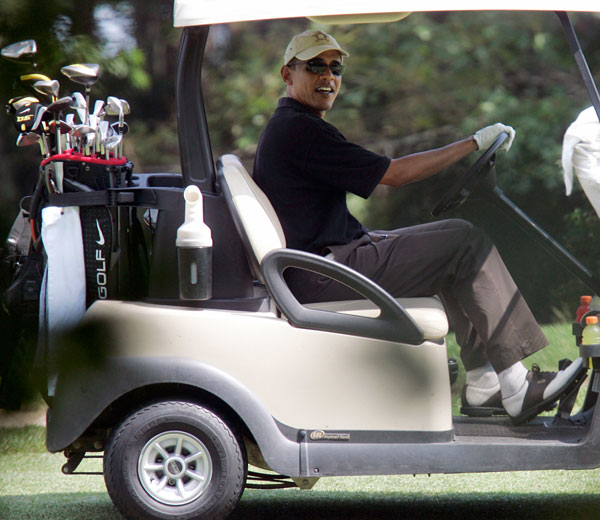 At both courses, Obama preferred to drive himself in a golf cart...