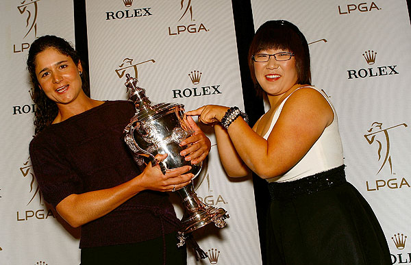 Lorena Ochoa narrowly grabbed Player of the Year honors from Jiyai Shin, right, with a birdie on the final hole of the LPGA Tour Championship to win the title by one point. Shin had jokingly tried to steal the trophy from Ochoa, who has won it four times in a row now, during the LPGA's awards reception earlier in the week.