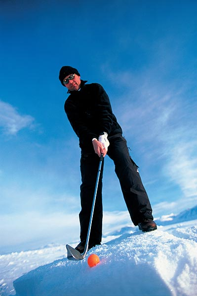 Brightly colored balls help players keep track of them in the white landscape.                                               Golf's Frozen 4 | Winter Survival Guide