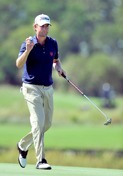 Webb Simpson fired an opening-round seven-under 63 to take the lead.