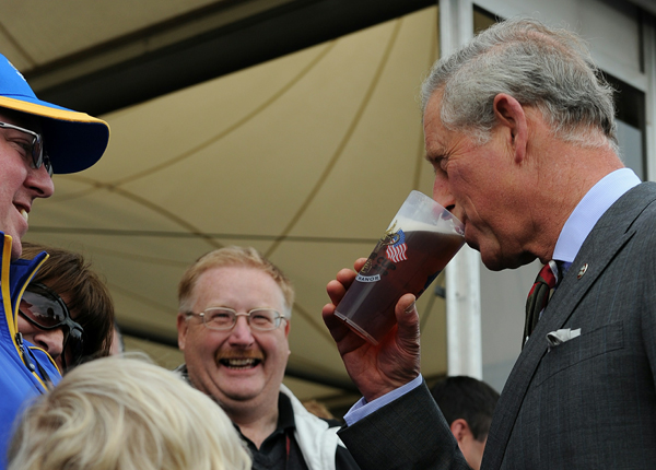 took a sip from a fan's beer when he visited Celtic Manor on Wednesday.