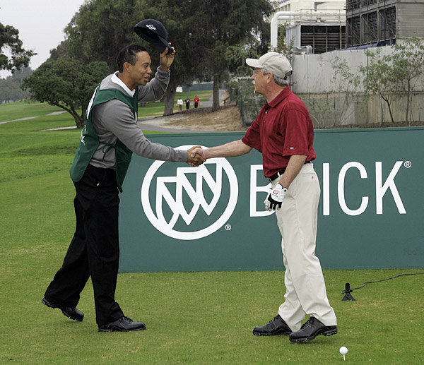Woods caddied for John Abel, 59, a pressman from New Jersey.