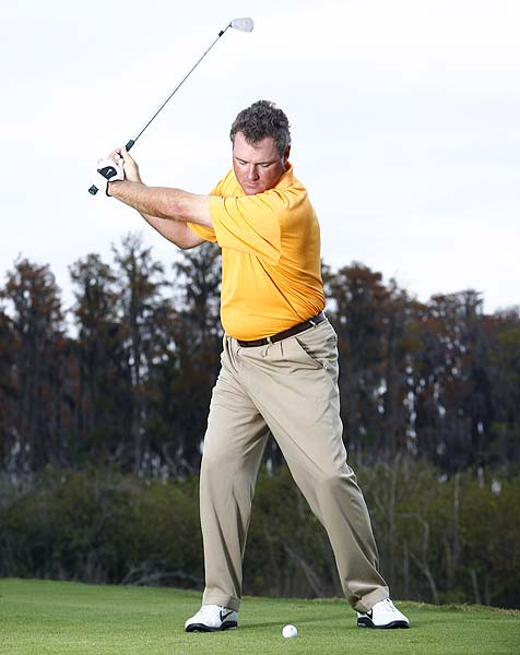 BACKSWING                                              Do... Keep your torso in place as you swing back, and turn your upper body away from the target just enough to make your left shoulder even with the ball. Hinge your wrists early and completely. That's what gives you a steep swing.                                              Don't... Take the club away low like you do with your driver. That delays your wrist hinge and ruins your timing.