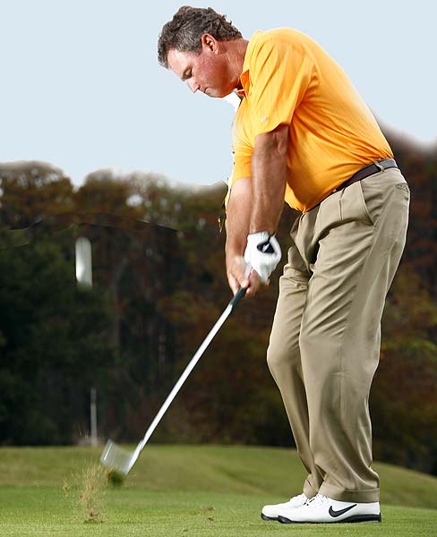 DOWNSWING                                              Do... Move your shirt buttons back to your left leg to help you hit down on the ball. The force of your forward motion will cause your wrists to unhinge and power the club into the back of the ball and then into the turf. Stay down and stay centered—see if you can catch a peek at your divot before you pull up into your finish.                                              Don't... Leave your weight on your back leg or you'll get that weak flare you're trying to avoid.