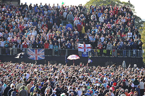 Fans stormed the 17th green after Hunter Mahan conceded the final match to Graeme McDowell.