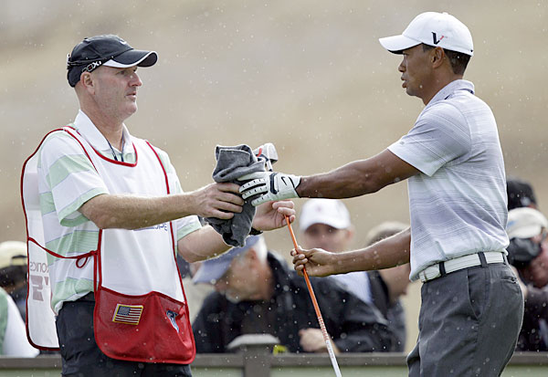 Woods has his new caddie on the bag this week, veteran Joe LaCava.