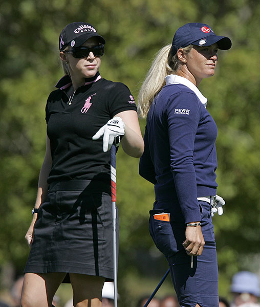 Defending champ Suzann Pettersen, right, played with Morgan Pressel. Pettersen is two back of the leaders at four under.