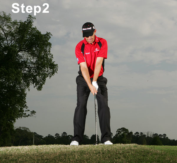 "Step 2: Be an Athlete                                                      Stay as relaxed as possible as you address the ball, with a feeling that your muscles are ""alive"" and ready to move you in any direction. Position the ball inside your left heel. (You'll have trouble if you use the more forward ball position of a fairway wood.) Hybrids play like irons, and that's how you should swing them. Make sure that your head is behind the ball and that your knees are directly above your shoelaces."