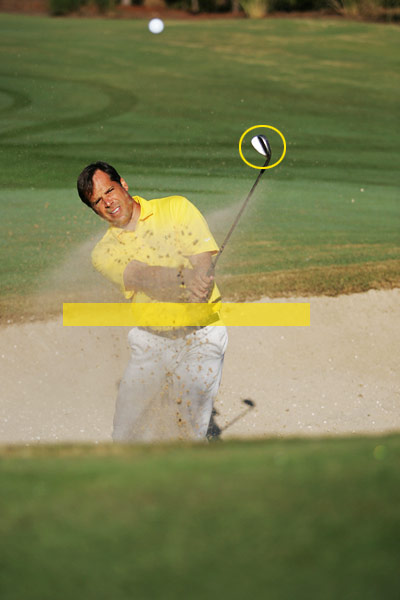 For bunker shots longer than 10 yards...                                                      Release the club like you do when you're hitting approach shots from the fairway. You don't need a full finish. What's important is that you release the clubhead so that your left palm faces the sky. You know you're doing it right when the clubhead finishes high above your hands. This type of release adds extra oomph to your sand swing, helping you to fly the ball all the way to the hole.