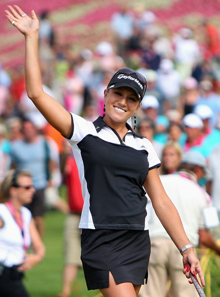 "After a stellar amateur career and five up-and-down years as an LPGA Tour pro, Natalie Gulbis finally broke through for her first win with a playoff victory over Jeong Jang at the 2007 Evian Masters.                                               ""Natalie has a very long, very powerful move through the ball,"" says Top 100 Teacher Dana Rader, founder of the Dana Rader Golf School at the Ballantyne Resort in Charlotte, N.C. ""But it's a swing that features a unique compensating move: Because her right forearm is still under her left forearm through impact, she drops her head and right shoulder down after impact to create room to release her forearms. It's hardly textbook, but it's worked well enough for Natalie to put her in the top 50 in all-time LPGA earnings after just six seasons.""                                              Analysis by Top 100 Teacher Dana Rader                       Ballantyne Resort, Charlotte, N.C."
