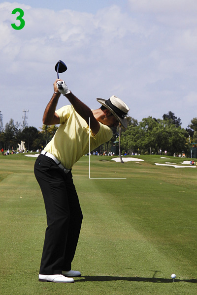 3. Alvaro continues to turn his body and fold his right elbow. The folding action allows him to cock his wrists to the max and add an extra power lever to his swing. Check out how his shaft points parallel left of his target line.