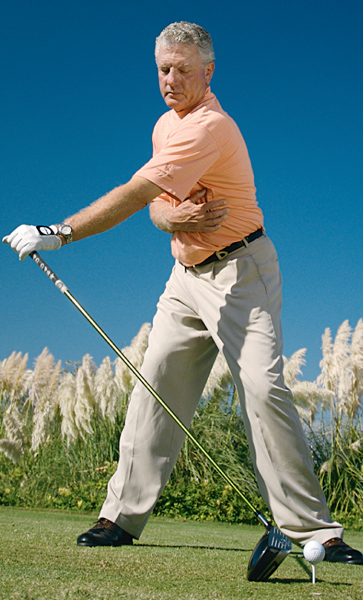 "2. Create a power line                                              Setup: Take your stance, remove your right hand from the club and extend your left arm straight out in front of you so your club stands straight up and down. Pull your right arm across your belly and brace your right hand against your torso.                                              Action: Push the grip end of the club as far away from the target as you can without lifting the clubhead off the ground. As you do this, use your right arm to keep your left shoulder from turning past your belt buckle. This drill teaches you to:                                              1. Keep your chest pointed at the ground.                                              2. Correctly turn your left shoulder.                                              3. Load up behind the ball for power. Look for a line that runs from the outside of your left foot to the top of your spine.                                              Benefit: The ""power line"" from your left foot to your spine indicates a full turn without loss of posture, and is the hallmark trait of any big hitter. — Top 100 Teacher Bruce Hamilton"