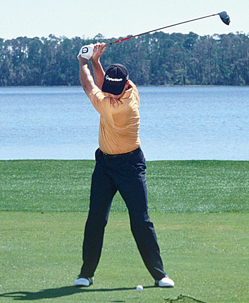 TOP O-FACTOR                           RETIEF GOOSEN                           Driving Avg: 297.6 yds                           The swing that has captured two U.S. Opens is an excellent one to copy, especially at the top. Check out Goosen's hips—they couldn't get more level. He moves them to O-Neutral at the top while turning his left shoulder under his chin. Also notice how Goosen uses his left knee to drive his weight back.