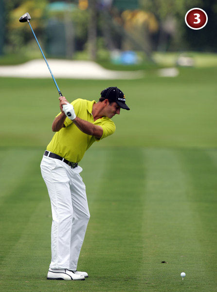 The early wrist set                           creates a steep shaft                           angle near the top of                           his swing and a noticeable                           cup in his left wrist. This                           isn't particularly unusual                           or damaging, except that he                           maintains the cup deep                           into his downswing.
