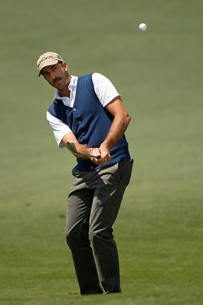 Vested Interest                       Australian Geoff Ogilvy, who tied for 19th, wore a short-sleeve golf shirt with a sweater vest -- kind of a nerdy look -- on day two of the Masters. With the new mustache, you found yourself wondering: Is it really him?