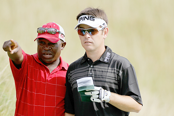 and his caddie Zack Rasego are looking to capture their second major title of the year.