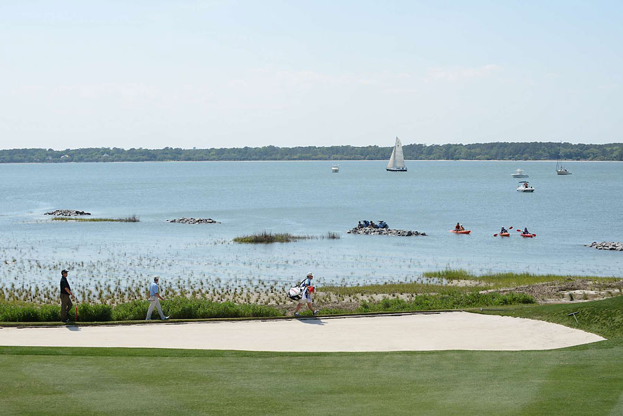 Want to get close to the golf action? Kayakers watch from the water as the Tour pros approach the 18th green.