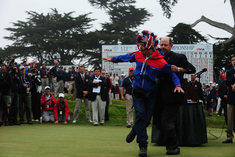 The USGA's Mike Davis removed an eager fan who interrupted the trophy presentation.