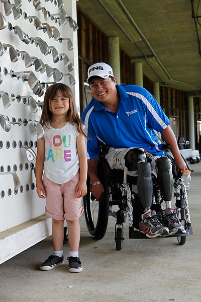 Holbert has less use for his wheelchair on the golf course. While many double amputees play by strapping themselves into a miniature cart called a Paragolfer, Holbert prefers to stand.