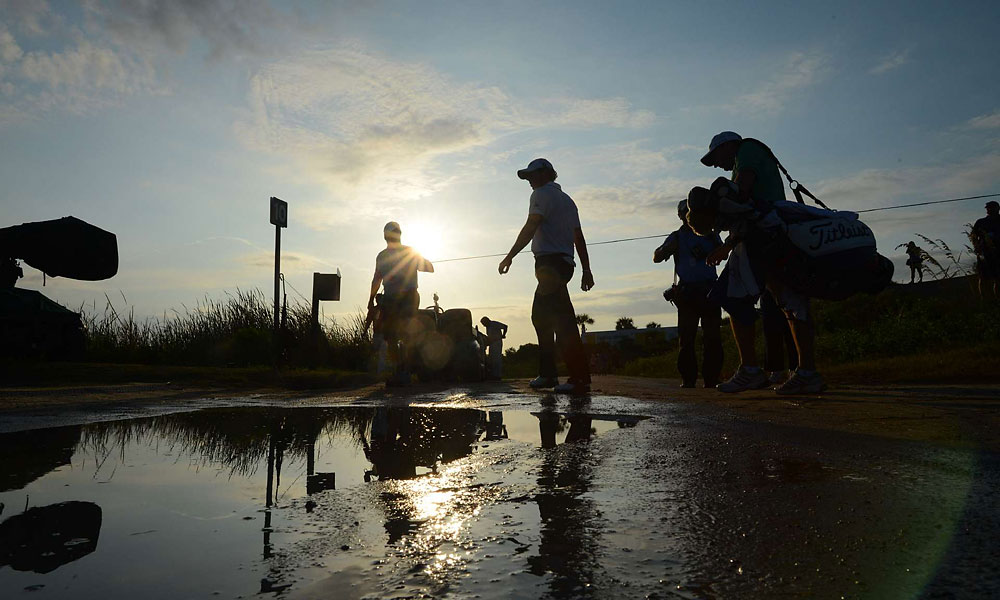 A rain delay on Saturday forced some players, including McIlroy, to finish their rounds early Sunday morning.