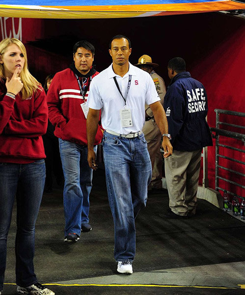 Tiger walks the 2012 Fiesta Bowl catwalk in his signature off-course look.