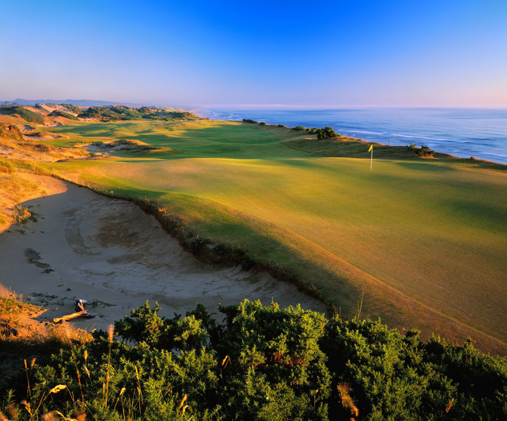 Pacific Dunes -- Bandon, Ore. -- No. 13: Par 4, 444 yards                       A gigantic natural dune flanks the fairway to the right, while the Pacific Ocean looms below the cliffs on the left. Scattered blow-out bunkers lend further beauty and menace up the right side. The vistas are so distracting, it's easy to forget this is a modern masterpiece of design.