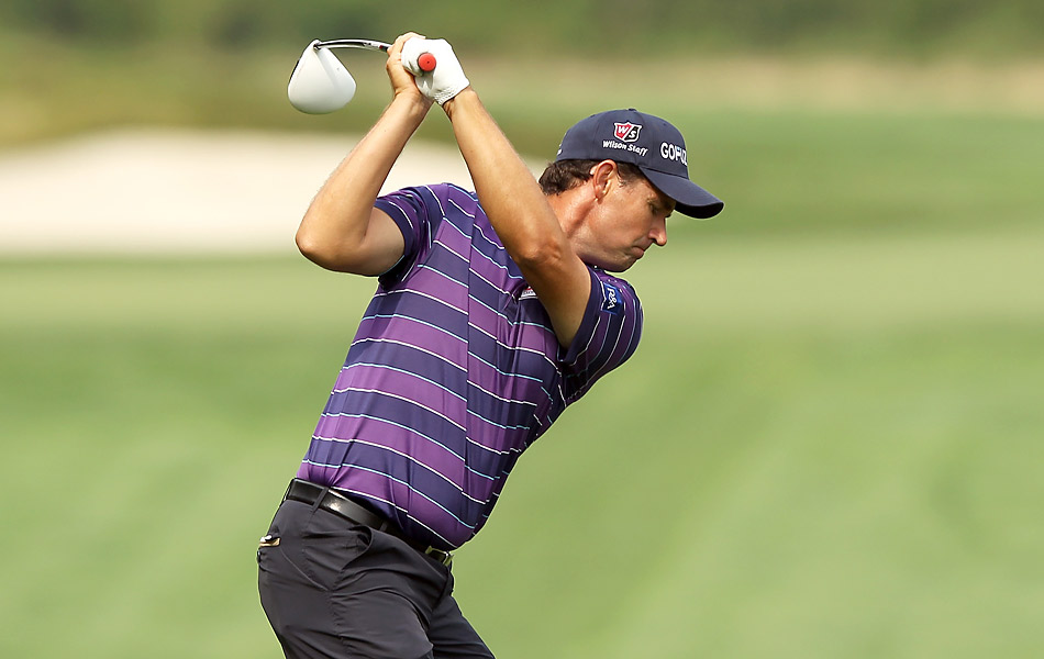 Fighting for a Ryder Cup captain's pick, Padraig Harrington fired an impressive seven-under 64 to take the lead.